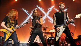 A picture of Dave Mustaine onstage with Metallica in 2011