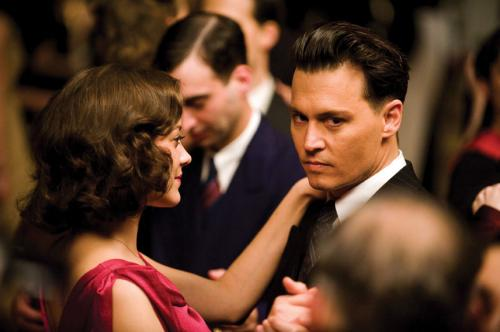 Public Enemies - Johnny Depp plays Depression-era outlaw John Dillinger, here with gangster's moll Billie Frechette (Marion Cotillard)