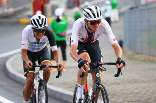 Brandon McNulty (USA) and Richard Carapaz (Ecuador) in the men's road race at the Tokyo Olympic Games