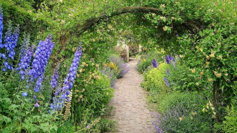 how much does a cottage garden cost? what to budget for: arch over path