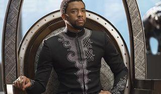 Black Panther Chadwick Boseman T'challa sits on his throne