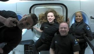 The four private astronauts of SpaceX's Inspiration4 mission smile in space in this still image from Sept. 16, 2021. From left they are: Jared Isaacman, commander; Hayley Arceneaux, medical officer; Chris Sembroski, mission specialist; Sian Proctor, pilot.