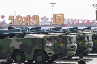 Military vehicles carrying DF-17 missiles parade through Tiananmen Square in Beijing on Oct. 1, 2019, celebrating the 70th anniversary of the founding of the Peoples Republic of China.