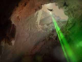 Catching a ride on a drone, OrganiCam could swoop into lava-tube caves on Mars to search for organic molecules marked by the tell-tale signature of life.