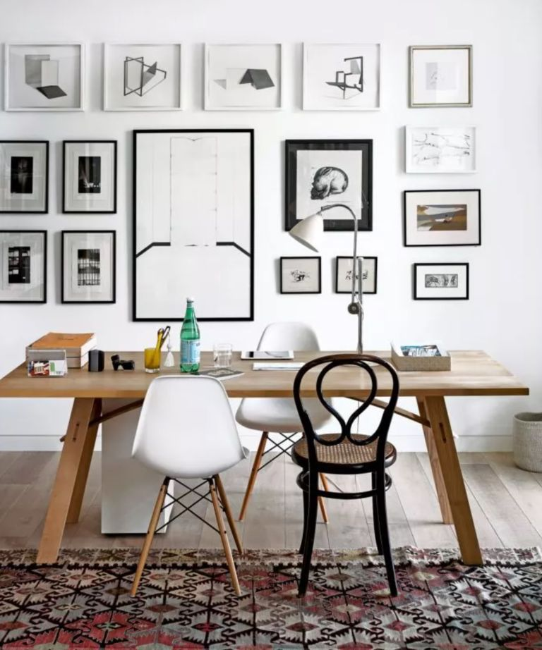 An open-plan home office with seating for two