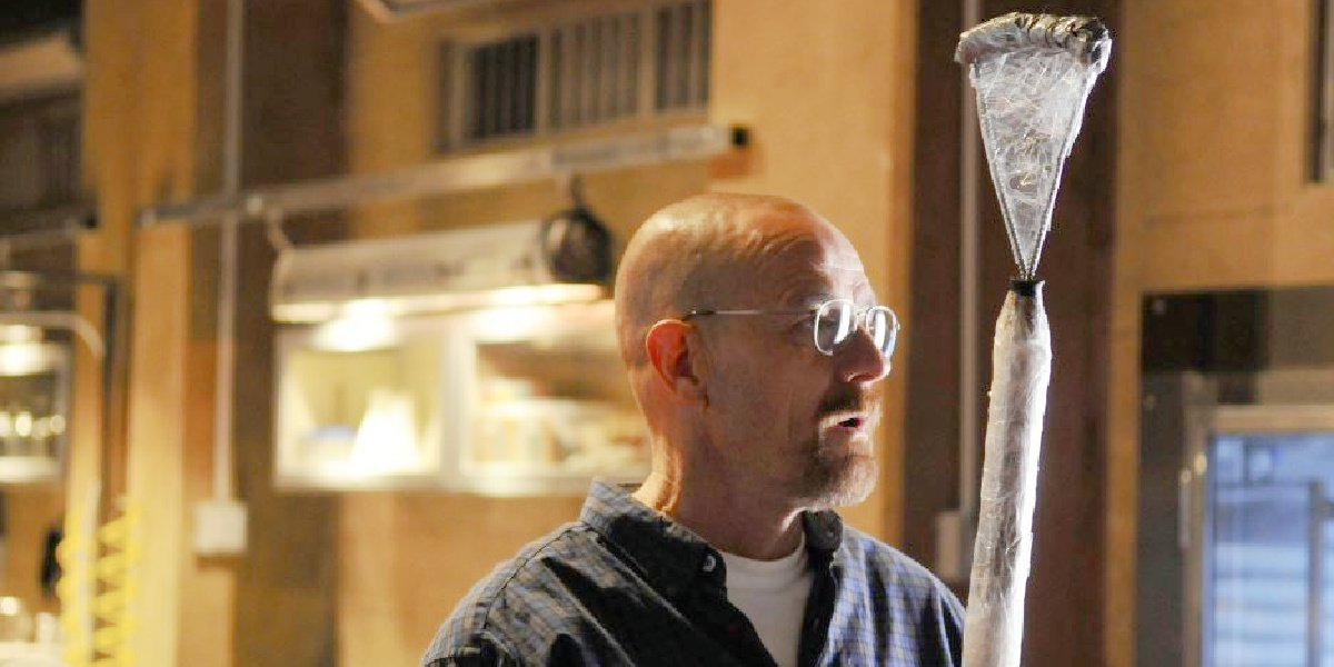 """Walter White with one of his fly murdering weapons in """"Fly"""" on Breaking Bad."""