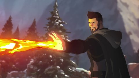 Young White Man wearing all black with hand raised and flames shooting out of his palm