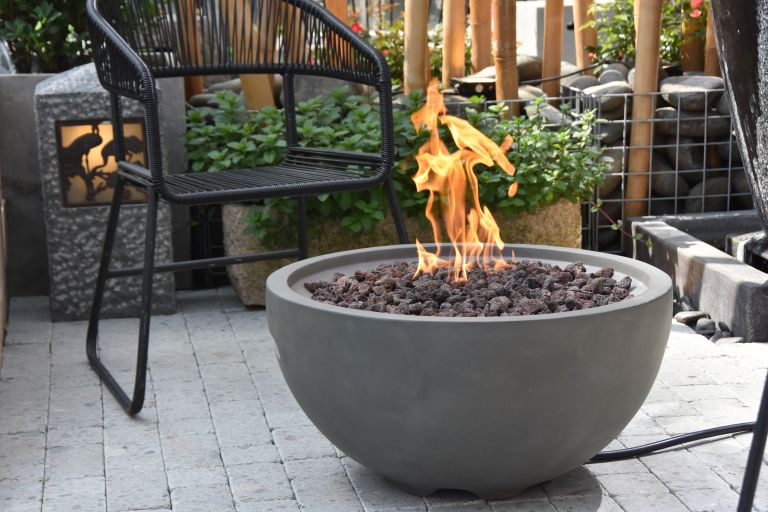 gas fire pit in a grey bowl design on a patio