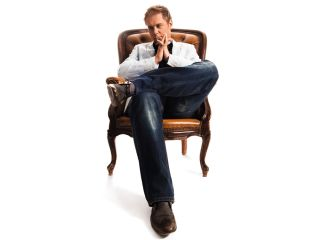 Armin van Buuren ponders his greatness on his amazing flying chair.