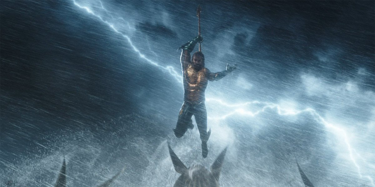 Aquaman leaps with his trident in the final battle against Orm in Aquaman