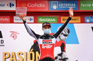 OURENSE SPAIN NOVEMBER 04 Podium Tim Wellens of Belgium and Team Lotto Soudal Celebration Trophy Mask Covid safety measures during the 75th Tour of Spain 2020 Stage 14 a 2047km stage from Lugo to Ourense lavuelta LaVuelta20 La Vuelta on November 04 2020 in Ourense Spain Photo by Justin SetterfieldGetty Images