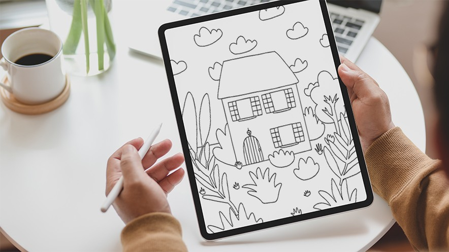Person using colouring template on an iPad