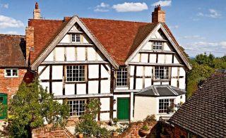sloper black and white timber house