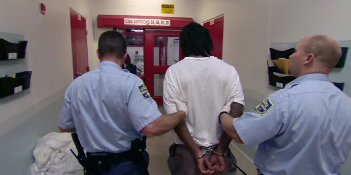 A scene from 13th of a black man being arrested