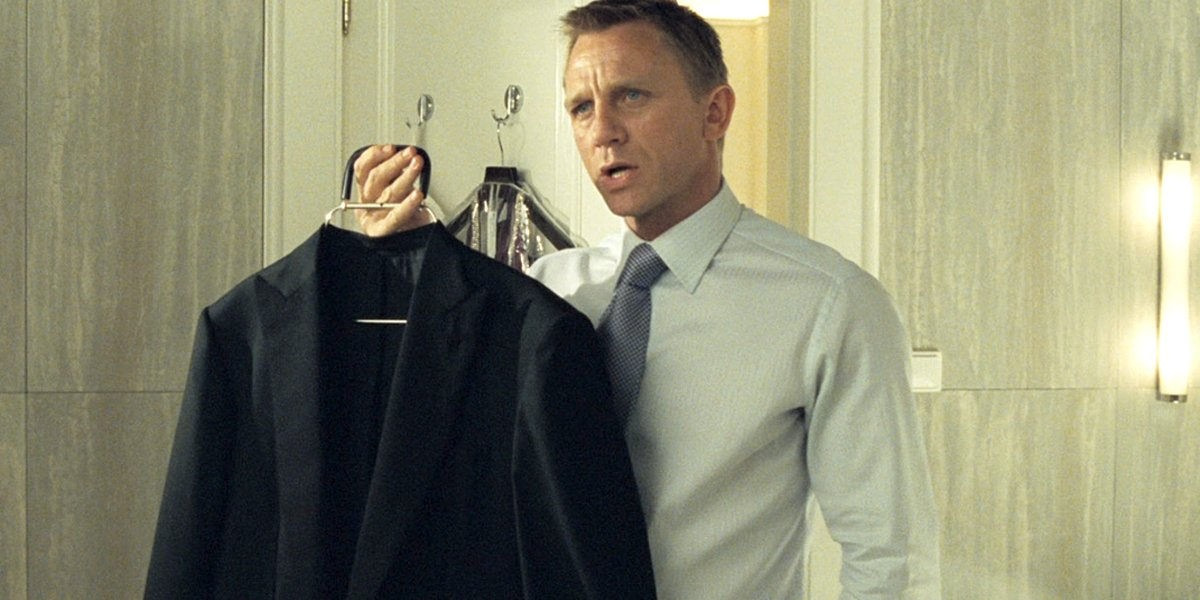 Daniel Craig James Bond holds dinner jacket Casino Royale