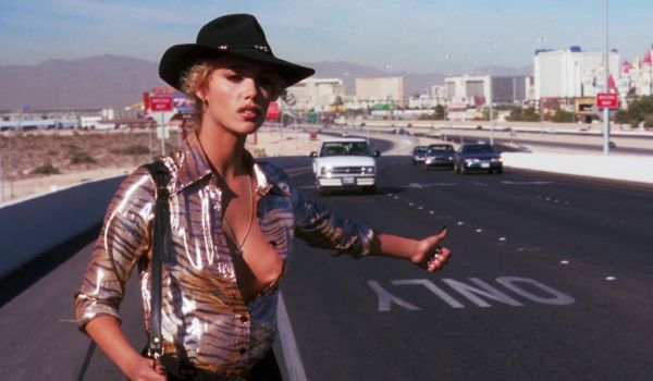 Elizabeth Berkeley hitching a ride in Showgirls