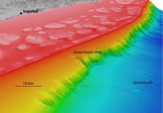 A view of the Gloria Knolls Slide off Queensland, Australia, and adjacent seafloor features; colors represent the depth of the features beneath the water surface (red is the shallowest, indicating the tallest features, while purple and blue are the deepes