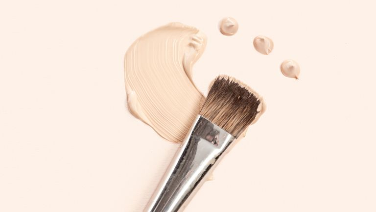 Makeup brush with smudge of foundation