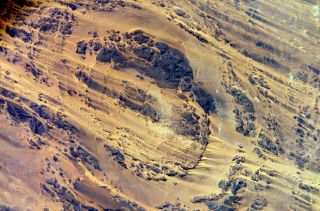 Astronaut Clayton C. Anderson tweeted this picture from space, a view of Aorounga Impact Crater, southeast of of Emi Koussi volcano in Chad.
