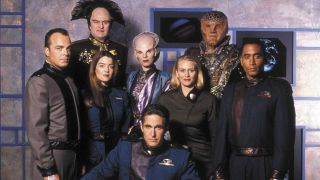 The Season 1 cast standing in Michael O'Hare's office in Babylon 5