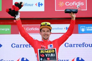 ALTO DE LA MONTAA DE CULLERA SPAIN AUGUST 19 Primoz Roglic of Slovenia and Team Jumbo Visma celebrates winning the Red Leader Jersey on the podium ceremony after the 76th Tour of Spain 2021 Stage 6 a 1583km stage from Requena to Alto de la Montaa de Cullera 184m lavuelta LaVuelta21 on August 19 2021 in Alto de la Montaa de Cullera Spain Photo by Stuart FranklinGetty Images
