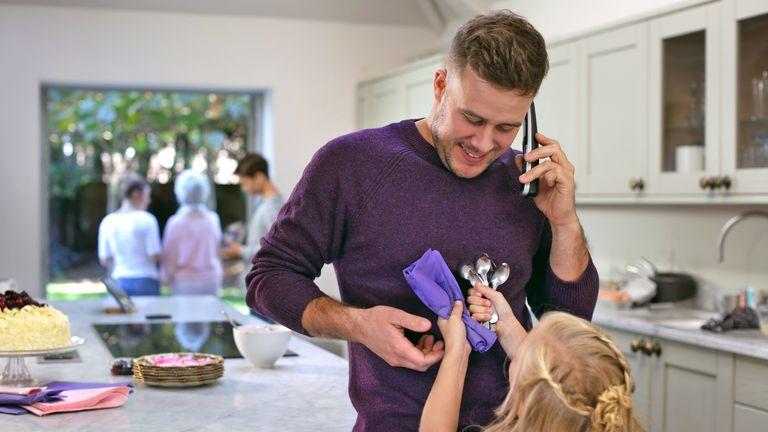 A man using a BT landline telephone