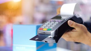 Person pays using POS hardware card reader