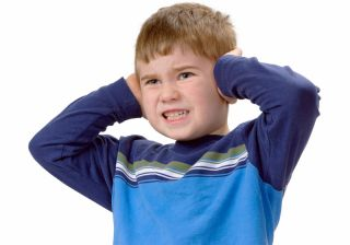 Child Covering His Ears with Hands