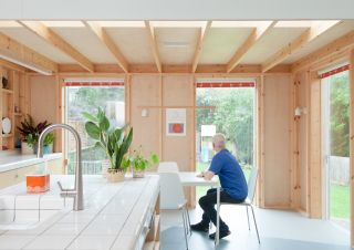 a timber frame extension with an exposed frame