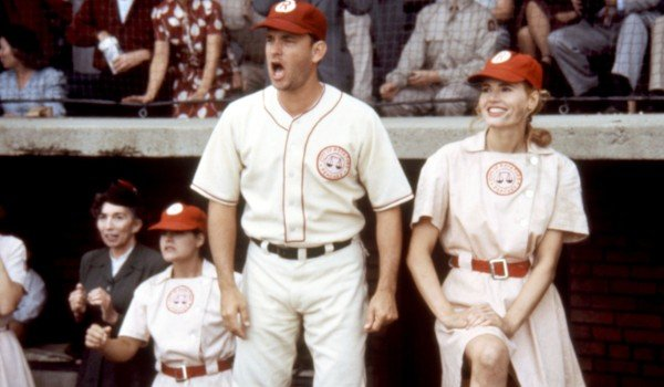 A League of Their Own Tom Hanks yells from the dugout as Geena Davis smiles
