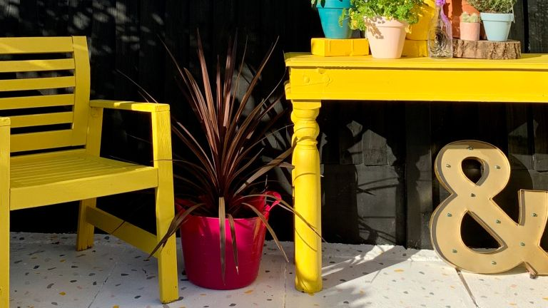 painted patio floor with yellow table