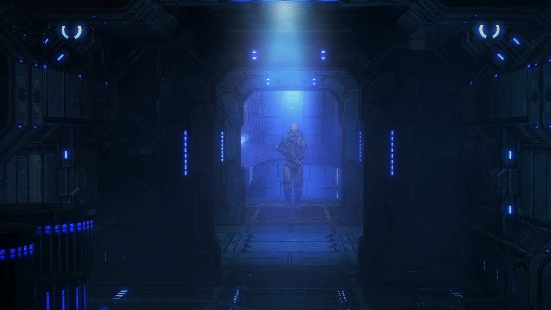 Screenshot showing a soldier walking in a dimly-lit hallway