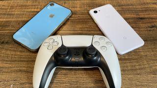 A DualSense controller next to an iPhone and Google Pixel