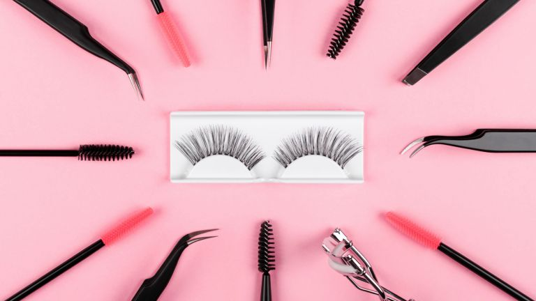 False lashes, tweezers and lash comb