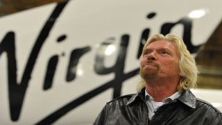 Sir Richard Branson speaks to AFP during an interview before the official unveiling of Virgin Galactic's SpaceShipTwo, the world's first commercial manned spacecraft, at the Mojave Air and Space Port in Mojave, California on December 7, 2009.