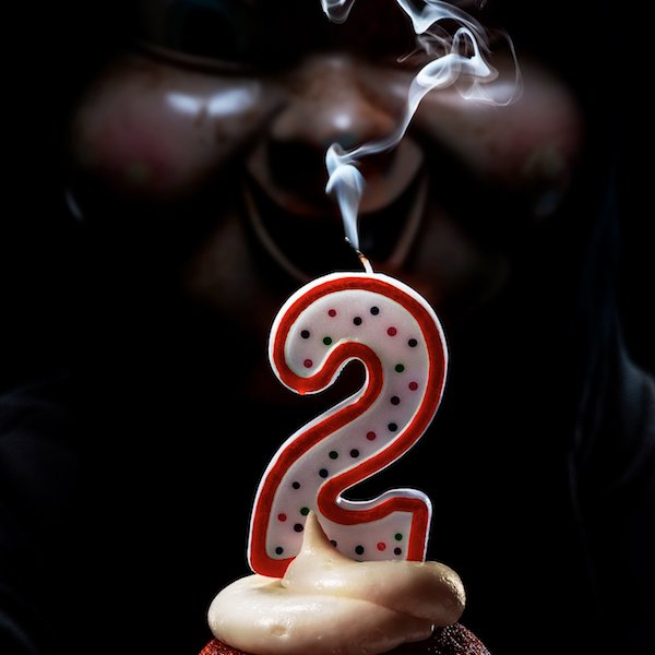 Happy Death Day 2U a clock with the killer's mask as the face