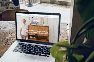 Laptop open on a website on a desk
