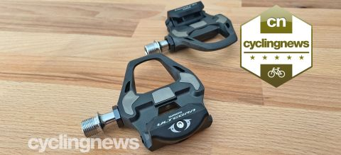 Shimano Ultegra pedals overlaid with a five-star badge