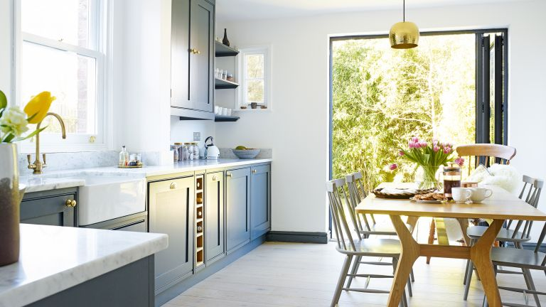 A wall of bi-fold doors make a small kitchen feel bigger