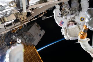 NASA astronaut Chris Cassidy works to install lithium-ion batteries on the International Space Station's truss structure during a spacewalk on July 16, 2020.