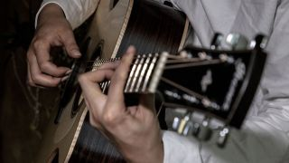 Close-up shot of guitarist playing Ibanez Fingerstyle Collection acoustic guitar