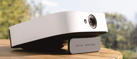 Anker Nebula Solar Portable projector on an outdoors table
