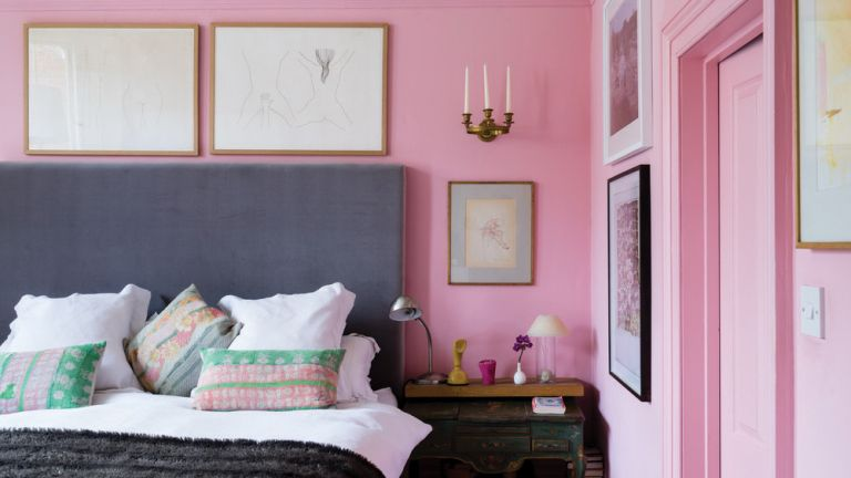 Pink bedroom with grey headboard