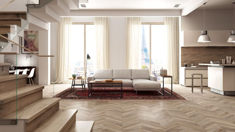 best wooden floor cleaners: living room that's light and airy with wooden flooring, rug and sofa
