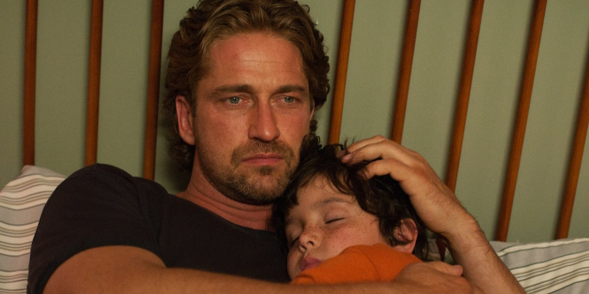 Gerard Butler and Noah Lomax in Playing for Keeps