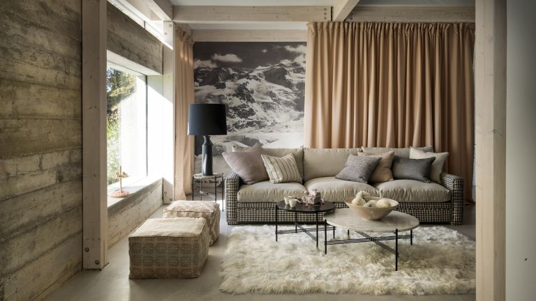 Wall mural ideas with an accent wall with black and white mountain design, and neutral soft furnishings in a chalet style room