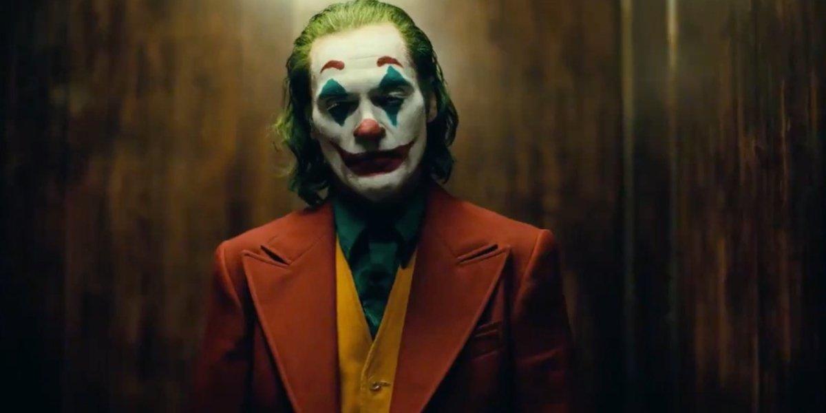 Joker standing in the elevator in full makeup