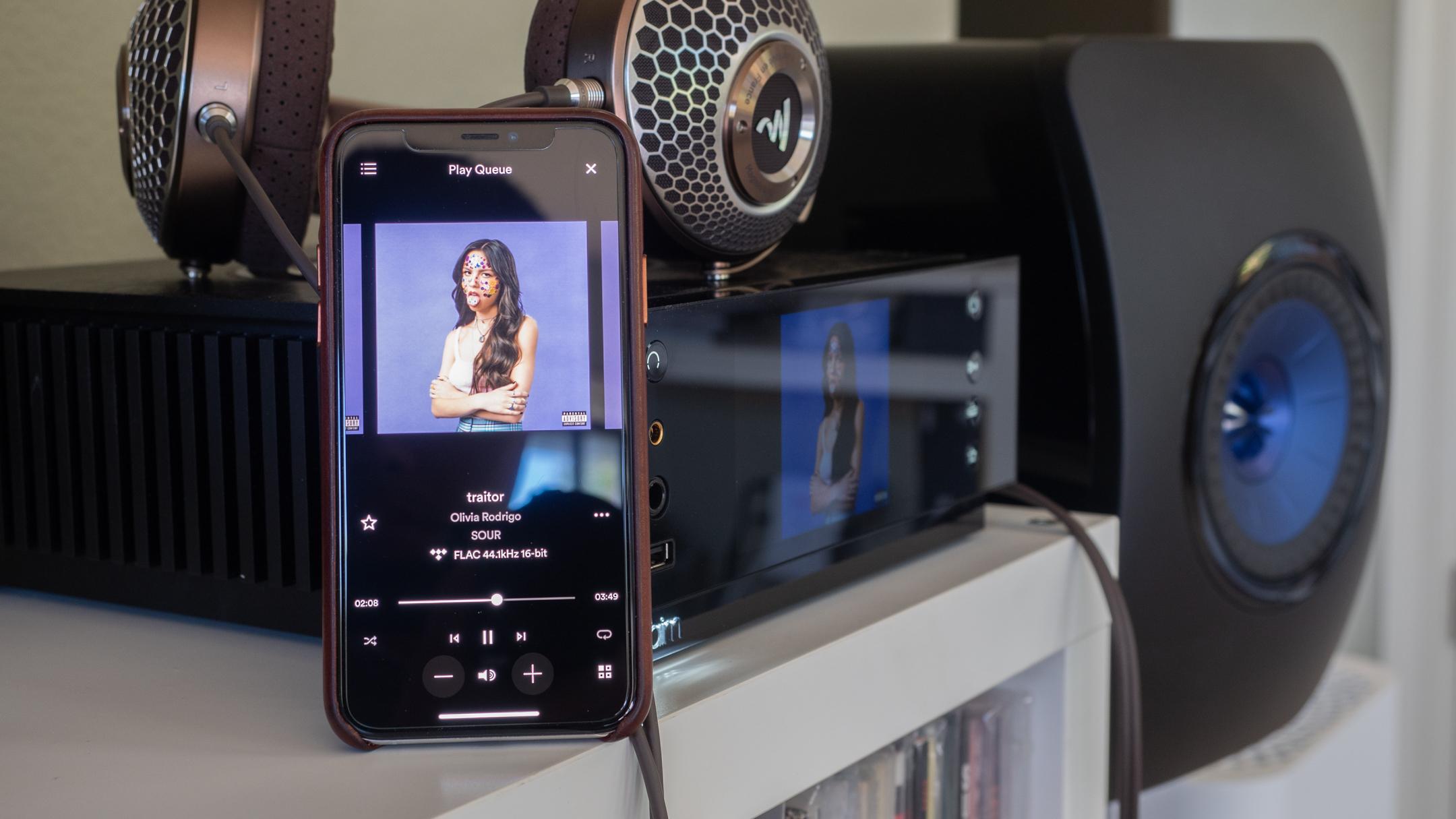 Pictured: Naim Uniti Atom Headphone Edition on a shelf.