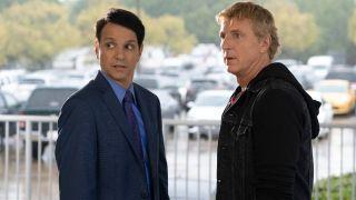 Daniel LaRusso (Ralph Macchio) and Johnny Lawrence (William Zabka) look around on Cobra Kai (2021)