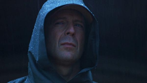 bruce willis in rain coat Unbreakable